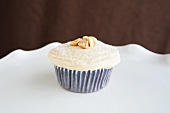 Chocolate Cupcake with Vanilla Frosting and Peanuts