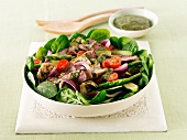Lamb, cherry tomato and lamb's lettuce salad with a green dressing