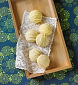 Lemon Tea Cookies on a Doily on a Wooden Tray