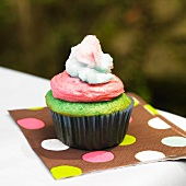 Green Cupcake with Pink Frosting and Cotton Candy on a Polk-a-Dot Napkin