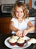 Five Year Old Girl Decorating Cupcakes