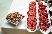 Bowl of Mixed Nuts and Two Platters of Italian Meat