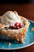 Individual Warm Cherry Pie with a Scoop of Vanilla Ice Cream