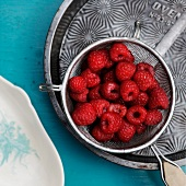 Fresh Red Raspberries in a Small Strainer