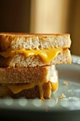 Grilled Cheese Sandwich on Crusty White Bread; Halved and Stacked