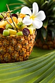 Fruit salad with exotic fruits in a hollowed out pineapple