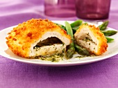 Chicken kiev with garlic butter, herbs and asparagus