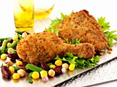 Breaded chicken legs with sweetcorn and beans