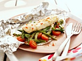 Cod with asparagus and tomatoes in foil