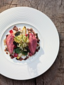 Wild pigeon breast with frisee lettuce