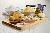 Ingredients for gnocchi, gnocchi dough and fresh gnocchi