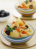 Conchiglie pasta with olives and tomatoes