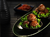 Meatballs on lettuce leaves