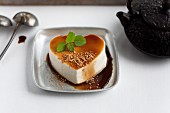 A heart made of tofu with a soy reduction