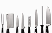 Kitchen tools (meat fork, meat cleaver, various knives and a knife sharpner)