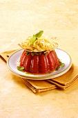 Tagliolini with pesto on tomato jelly