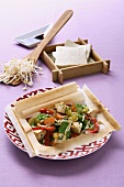 Oriental vegetables with tofu and ginger in baking paper
