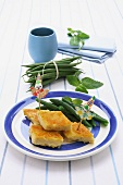 Rombi di farinata (spicy cake made of chickpea flour, Italy) with green beans