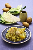 Savoy cabbage with fish and potatoes