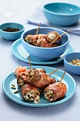 Beef roulade wrapped in ham with raisins and pine nuts