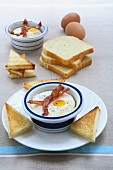 Oeuf cocotte with ham and toast
