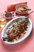 Marinated grey mullet with onions