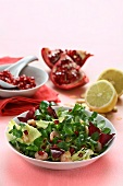 Lamb's lettuce with North Sea shrimps and pomegranate seeds