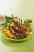 A rack of lamb with a mustard sauce