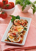 Boiled eggs with a mushroom and tomato sauce