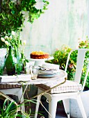 A table laid in the garden with lemon and polenta cake