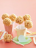 Honey and caramel lollies with puffed rice