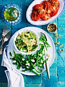 Orzo salad with chickpeas, green beans with feta, and roasted tomatoes for Easter (Greece)