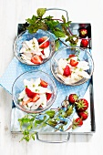 Asparagus and strawberry salad in glass bowls on a tray