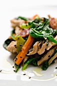 Stir-fried vegetables with chicken breast and sesame seeds
