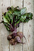 A fresh beetroot on a wooden surface