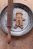 A gingerbread man on a metal plate