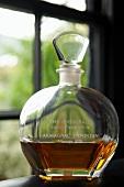 A bottle of Armagnac in a window