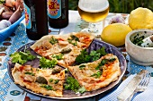 A pesto and caper pizza