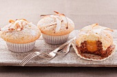 Muffins with apricot filling and strips of coconut