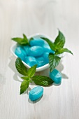 Blue mint bonbons and fresh mint