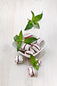 Peppermint bonbons and fresh mint