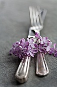 Silver cutlery with lilac flowers