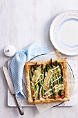 A square asparagus tart with Brie and ham