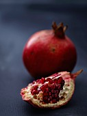 A whole pomegranate and a wedge