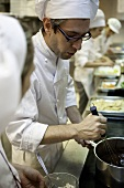 A young chef making chocolate cream