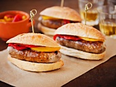 Sausage Sandwiches with Red and Yellow Peppers on Paper; With Toothpicks