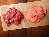 Raw Steaks and Steak Burgers on Parchment Paper