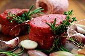 Raw beef medallions, garlic and herbs
