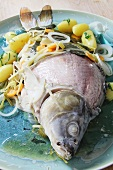 Blue carp with potatoes and vegetables