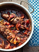 Venison shoulder with carrots and onions